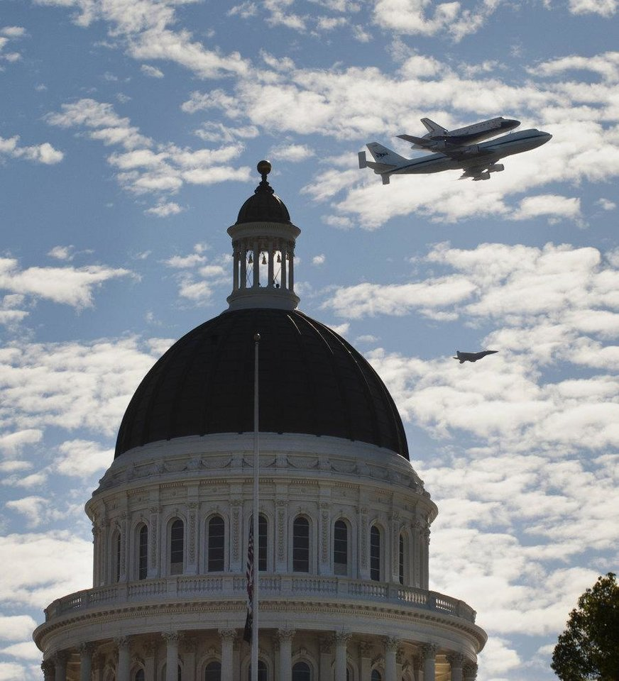 Photo -   Space Shuttle Endeavour mounted on NASA's Shuttle Carrier Aircraft, passes over the California state Capitol, Friday, Sept. 21, 2012, in Sacramento, Calif. Endeavour is making a final trek across the country to the California Science Center in Los Angeles, where it will be permanently displayed.(AP Photo/The Sacramento Bee, Lezlie Sterling) MAGS OUT; LOCAL TV OUT (KCRA3, KXTV10, KOVR13, KUVS19, KMAZ31, KTXL40); MANDATORY CREDIT