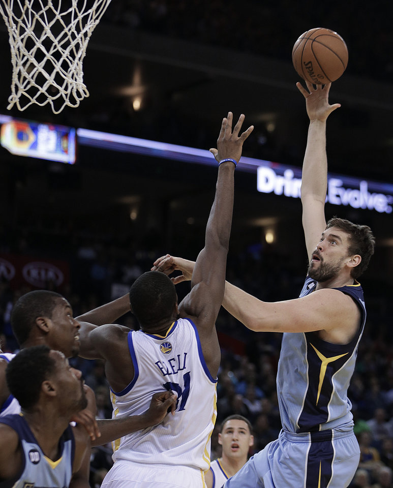 Memphis Grizzlies' Marc Gasol, right, shoots over Golden State Warriors' Festus Ezeli during the first half of an NBA basketball game on Wednesday, Jan. 9, 2013, in Oakland, Calif. (AP Photo/Ben Margot)
