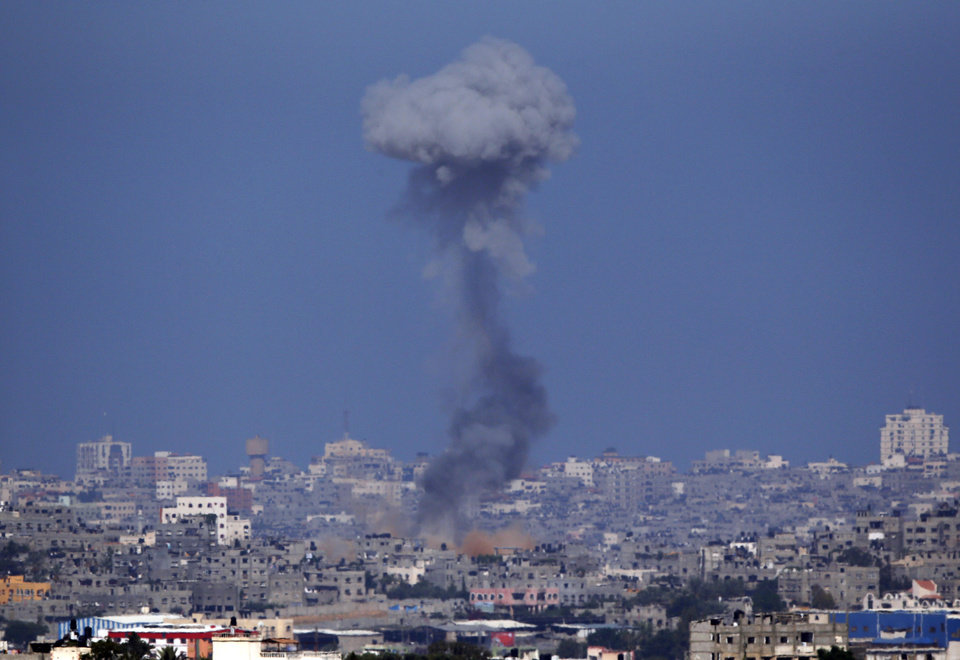 Photo - Smoke rises following an Israeli strike on Gaza, seen from the Israel-Gaza Border, Friday July 11, 2014. Rocket fire by Palestinian militants continued in earnest from Gaza toward various locations in southern Israel. (AP Photo/Lefteris Pitarakis)