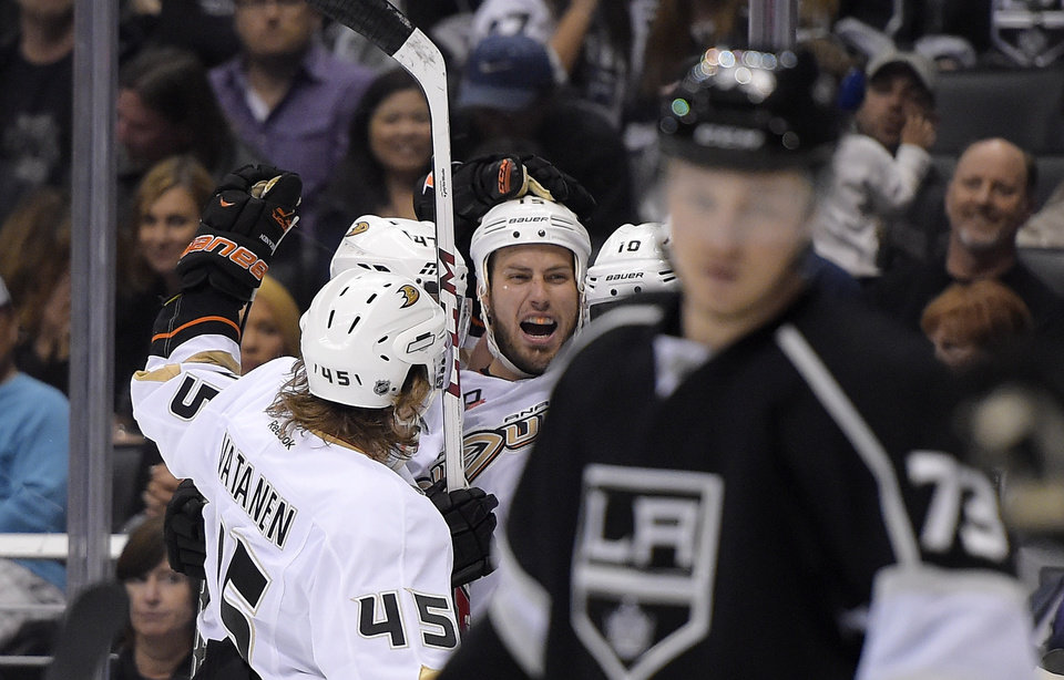 Photo - Anaheim Ducks center Ryan Getzlaf, third from left, celebrates his goal with teammates as Los Angeles Kings center Tyler Toffoli, right, looks on during the first period in Game 4 of an NHL hockey second-round Stanley Cup playoff series, Saturday, May 10, 2014, in Los Angeles. (AP Photo/Mark J. Terrill)