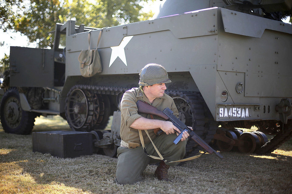 Jonathon Bernstein sits in front of an M-16 anti-aircraft vehicle during the presentation.