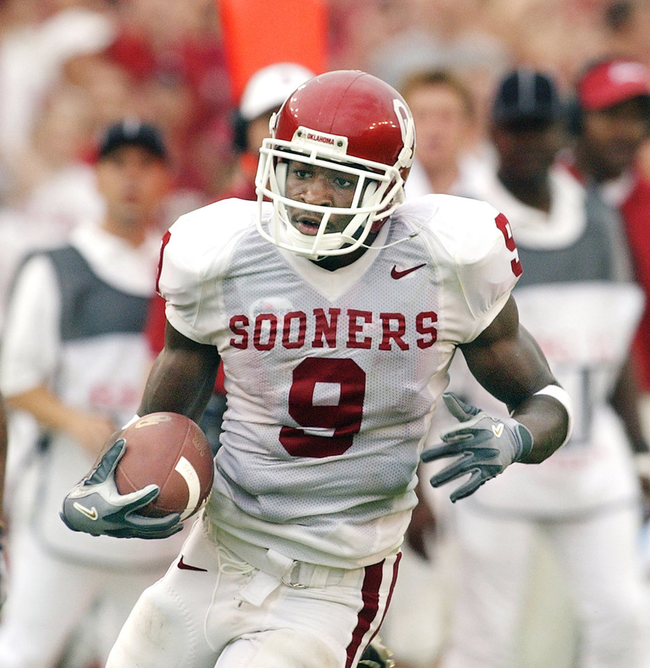 Photo - OU's 2003 road uniform. Worn by receiver Mark Clayton. PHOTO BY JIM BECKEL, The Oklahoman Archives