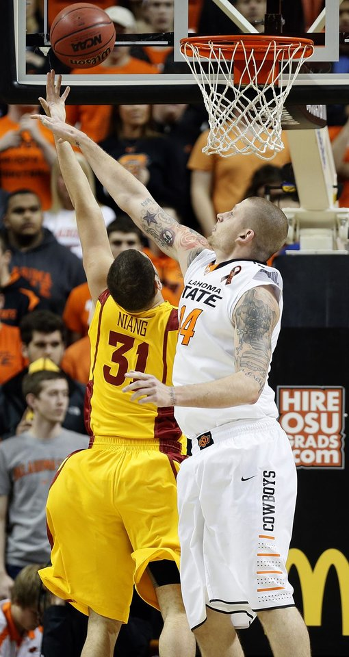 Photo - Oklahoma State Cowboys' Philip Jurick (44) tries to block a shot of Iowa State Cyclones' Georges Niang (31) during the college basketball game between the Oklahoma State University Cowboys (OSU) and the Iowa State University Cyclones (ISU) at Gallagher-Iba Arena on Wednesday, Jan. 30, 2013, in Stillwater, Okla.  Photo by Chris Landsberger, The Oklahoman
