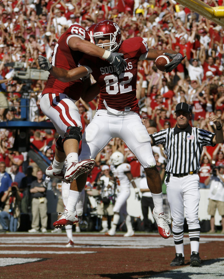 Photo - OU's James Hanna, right, and Eric Mensik celebrate after a touchdown during the first half of the Red River Rivalry college football game between the University of Oklahoma Sooners (OU) and the University of Texas Longhorns (UT) at the Cotton Bowl on Saturday, Oct. 2, 2010, in Dallas, Texas.   Photo by Bryan Terry, The Oklahoman
