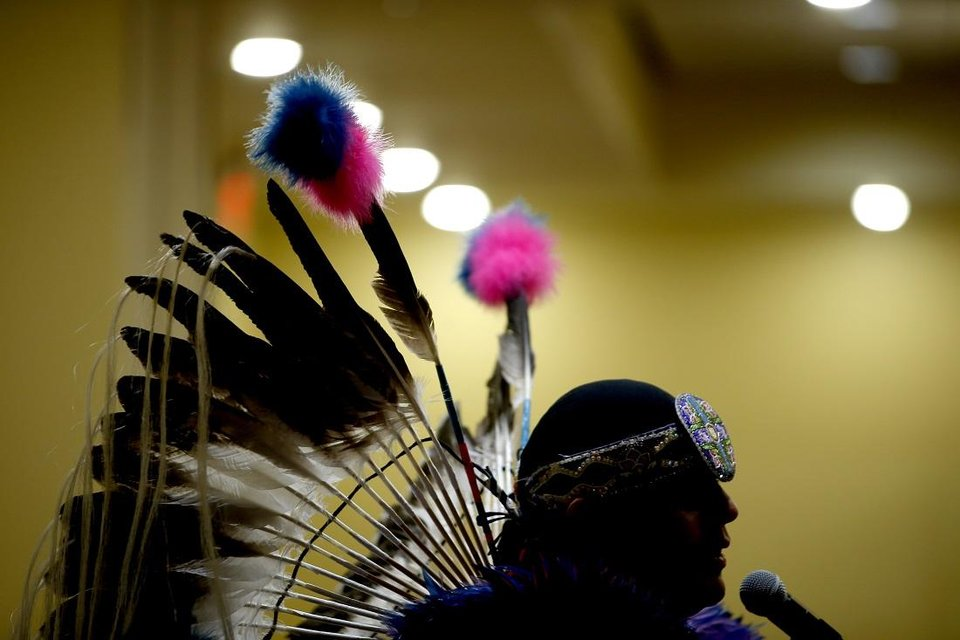 Photo - Cecil Gray, who is Kiowa and Cheyenne, speaks to a crowd during a dance exhibition by the Central Plains Dancers at the Red Earth Festival at Grand Event Center at the Grand Casino Hotel & Resort, Saturday, Sept. 5, 2020. [Bryan Terry/The Oklahoman]