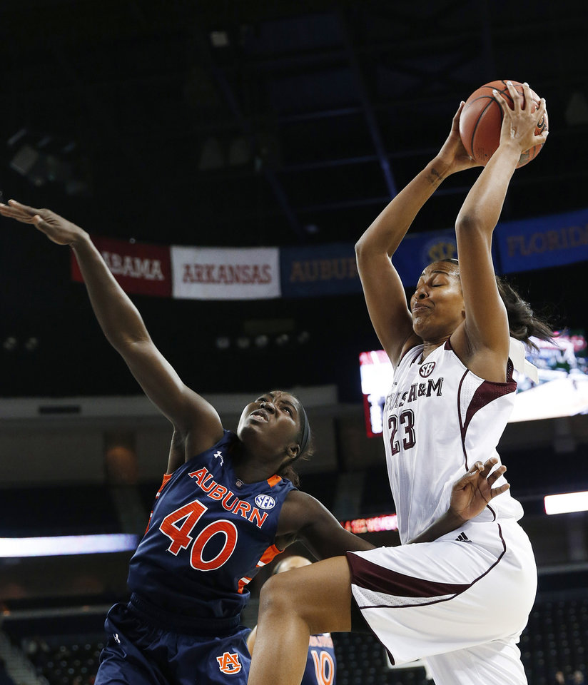 Photo - Texas A&M center Rachel Mitchell (23) goes up for a shot as Auburn guard Khady Dieng (40) defends during the first half in an NCAA college basketball game in the quarterfinals of the Southeastern Conference women's tournament, Friday, March 7, 2014, in Duluth, Ga. (AP Photo/John Bazemore)