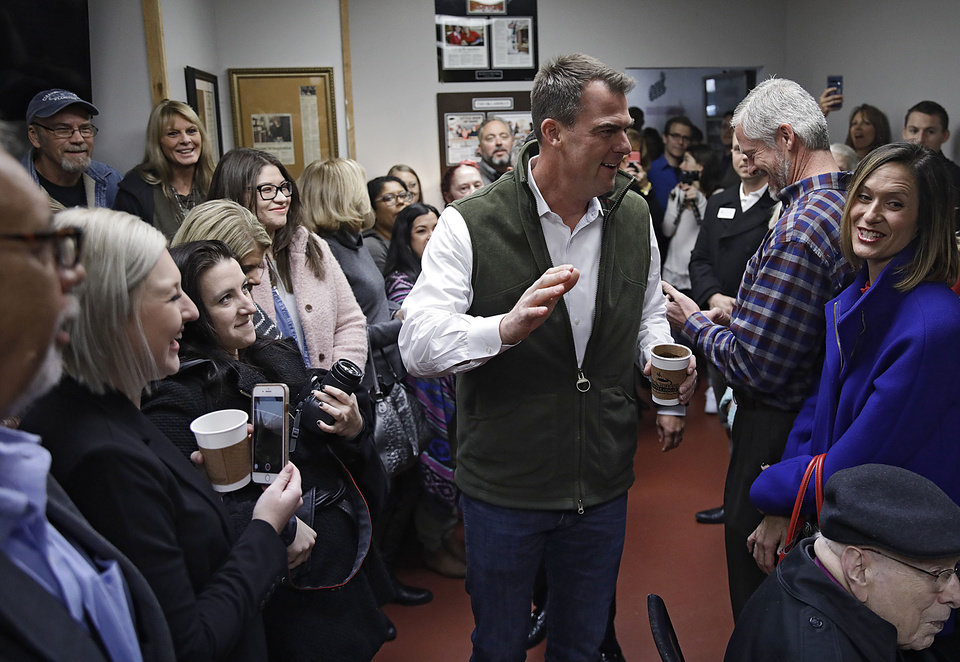 Photo - Oklahoma Gov. Kevin Stitt arrives at a crowded She Brews Coffee House to sign a pardon for Rhonda Bear in Claremore Thursday, Nov. 7, 2019. MIKE SIMONS/Tulsa World