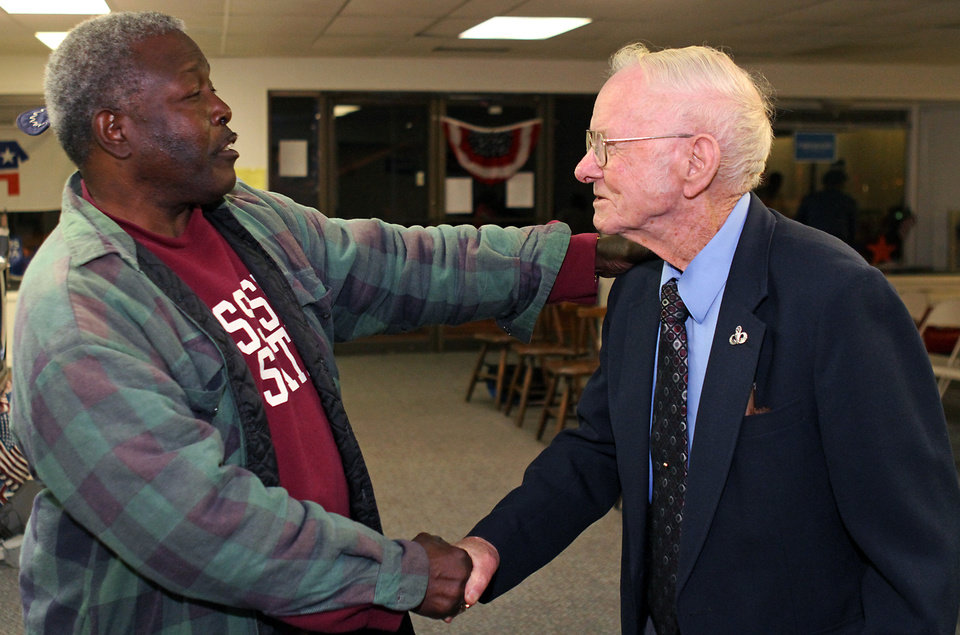 Photo -   Democratic senate candidate Albert N. Gore Jr., right, thanks supporter John Young for his vote Tuesday evening, Nov. 6, 2012 in Starkville, Miss. Gore seeks to unseat incumbent U.S. Sen. Roger Wicker, R-Miss. (AP Photo/Kerry Smith)