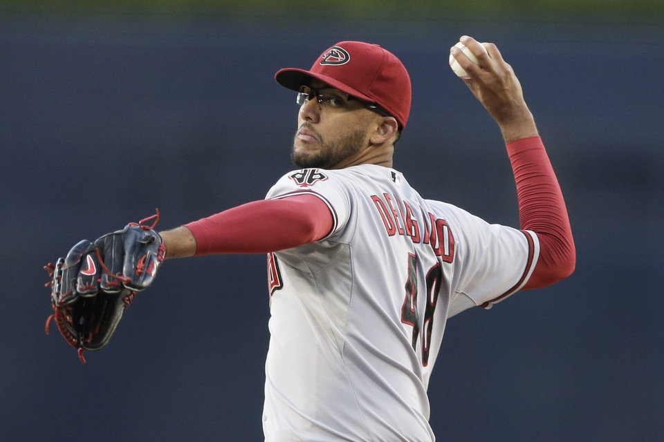 Photo - Arizona Diamondbacks relief pitcher Randall Delgado throws to a San Diego Padres batter during the first inning of a baseball game Thursday, Sept. 4, 2014, in San Diego. (AP Photo/Gregory Bull)