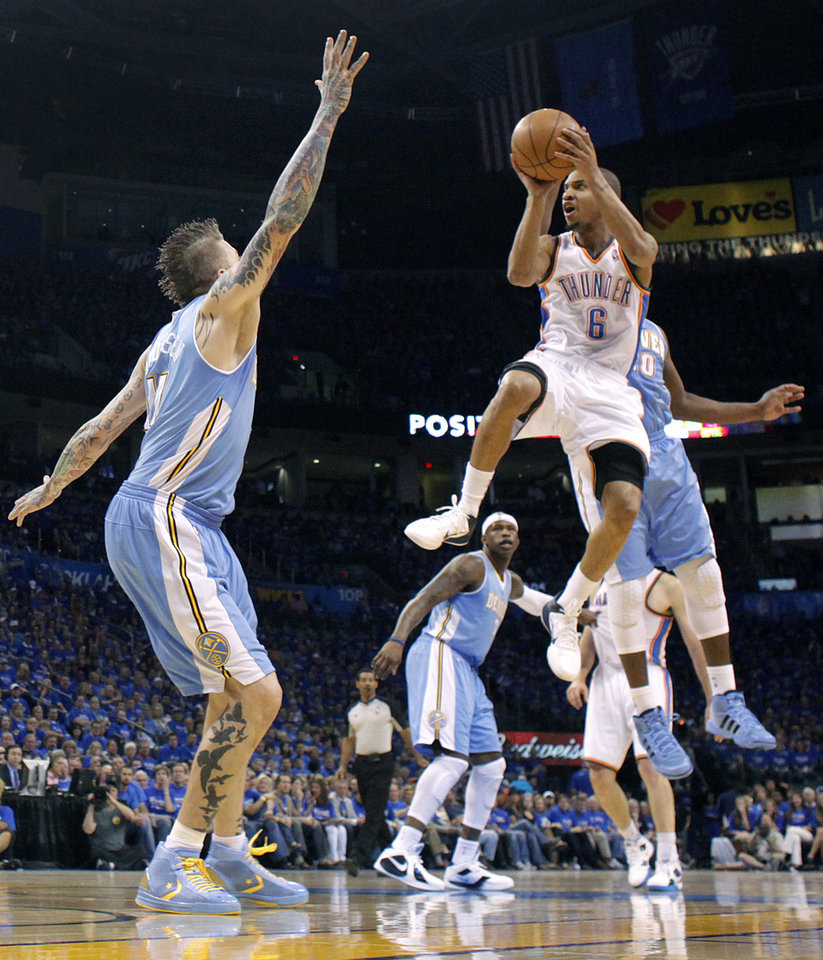 Photo - Oklahoma City's Eric Maynor (6) drives to the basket against Denver's Chris Andersen (11) during the first round NBA playoff game between the Oklahoma City Thunder and the Denver Nuggets on Sunday, April 17, 2011, in Oklahoma City, Okla. Photo by Chris Landsberger, The Oklahoman