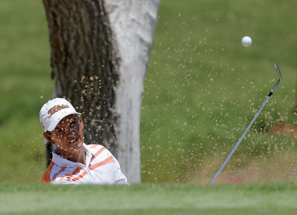 Photo - Tom Pernice Jr. practices hitting from a bunker on No. 7 during practice rounds for the U.S. Senior Open golf tournament at Oak Tree National in Edmond, Okla., Monday, July 7, 2014. Photo by Nate Billings, The Oklahoman