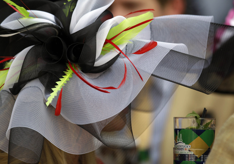 Erin Vangari of Louisville, Ky., wears a fancy hat in the paddock before the 138th Kentucky Derby horse race at Churchill Downs Saturday, May 5, 2012, in Louisville, Ky. (AP Photo/David J. Phillip)  ORG XMIT: DBY149