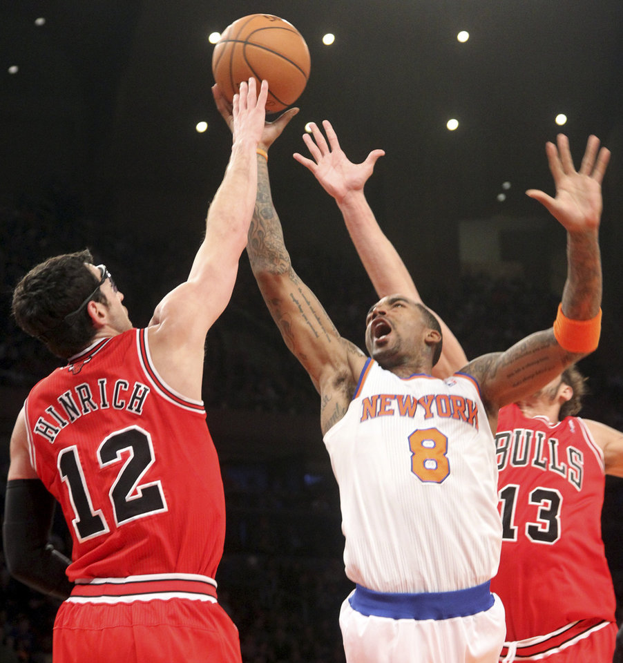 New York Knicks' J.R. Smith (8) goes to the the basket against Chicago Bulls' Kirk Hinrich (12) and Joakim Noah during the first half of an NBA basketball game on Friday, Dec. 21, 2012, at Madison Square Garden in New York.  (AP Photo/Mary Altaffer)