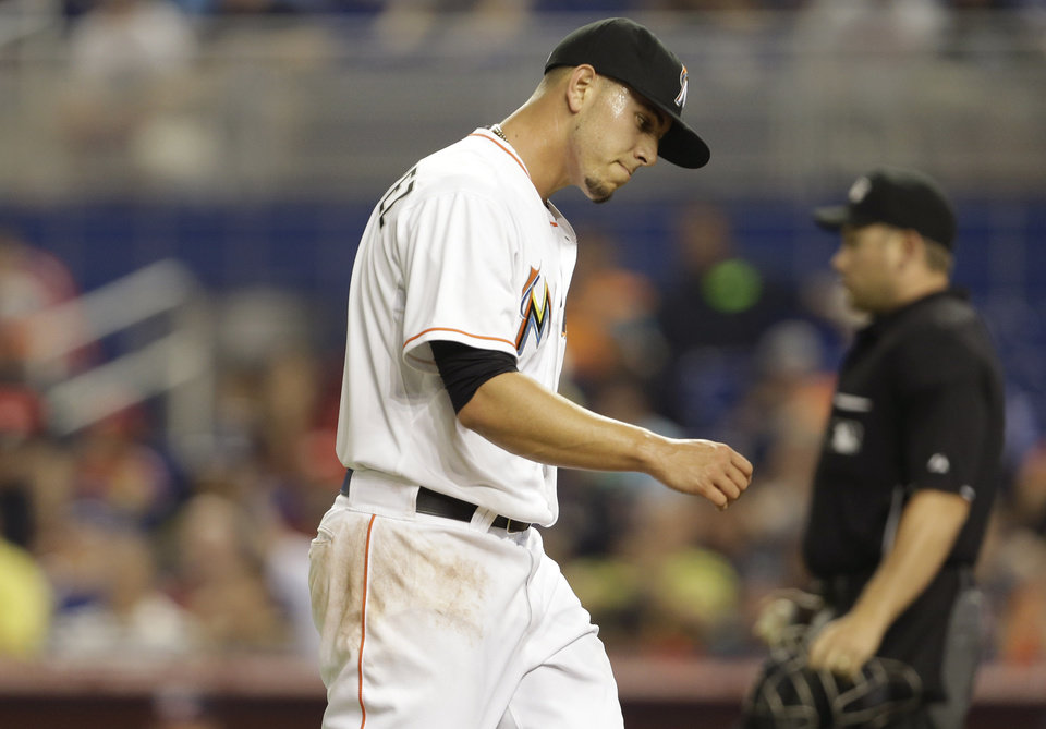 Photo - Miami Marlins starting pitcher Jose Fernandez walks to the dugout after pitching during the first inning of the MLB National League baseball game against the Washington Nationals, Wednesday, April 16, 2014, in Miami. (AP Photo/Lynne Sladky)