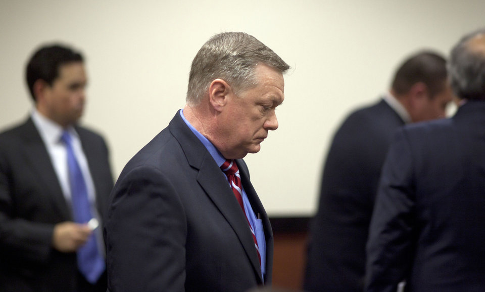 Photo - FILE - In this Feb. 21, 2013, file photo,  Former Fiesta Bowl CEO John Junker appears in Maricopa County Superior Court in Phoenix, Ariz. Junker, who acknowledged participating in an illegal campaign contribution scheme, faces sentencing Thursday, March 13, 2014, in federal court. Junker pleaded guilty two years ago to a federal conspiracy charge after being accused of being involved in the scheme in which Fiesta Bowl employees made illegal campaign contributions to politicians and were reimbursed by the nonprofit bowl.  (AP Photo/The Arizona Republic, Mark Henle, File)  MARICOPA COUNTY OUT; MAGS OUT; NO SALES.