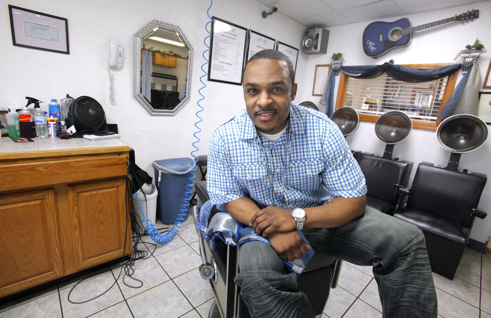 Hopkins Haircare and Enterprises barber Roger Nealy poses in his chair at the barber shop on Thursday, Feb. 23, 2012, in Midwest City. Photo by Paul B. Southerland, The Oklahoman