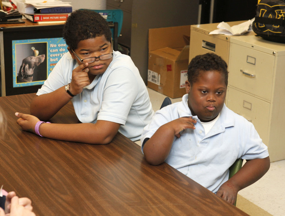 Photo - Special needs students Sherman Rex, left, and Christian Shelton listen to instructor Angie Absher Thursday at Johnson Elementary School. Photo by Paul Hellstern, The Oklahoman  PAUL HELLSTERN