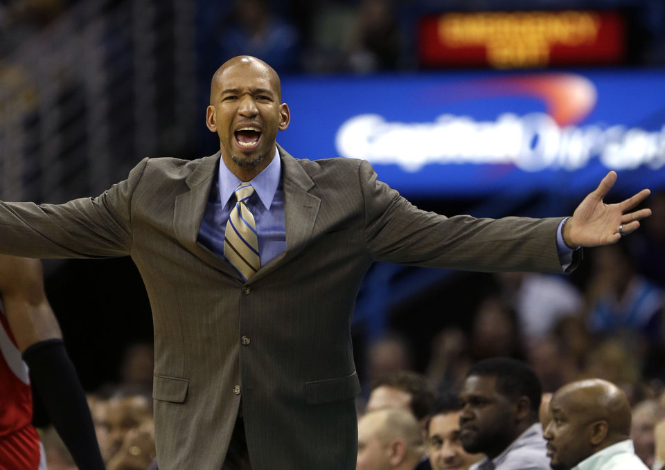 Photo - New Orleans Hornets head coach Monty Williams reacts to the officials in the first half of an NBA basketball game against the Houston Rockets in New Orleans, Friday, Jan. 25, 2013. (AP Photo/Gerald Herbert)