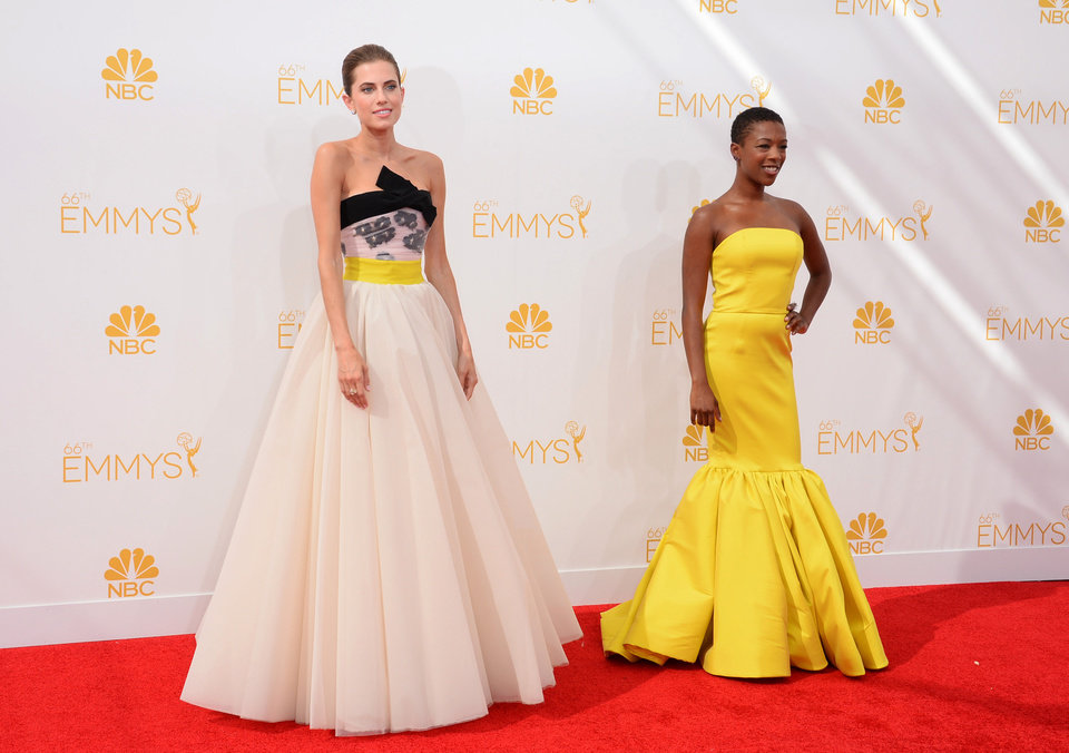 Photo - Allison Williams, left, and Samira Wiley arrive at the 66th Annual Primetime Emmy Awards at the Nokia Theatre L.A. Live on Monday, Aug. 25, 2014, in Los Angeles. (Photo by Jordan Strauss/Invision/AP)