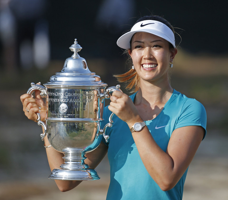 Photo - Michelle Wie poses with the trophy after winning the U.S. Women's Open golf tournament in Pinehurst, N.C., Sunday, June 22, 2014. (AP Photo/John Bazemore)