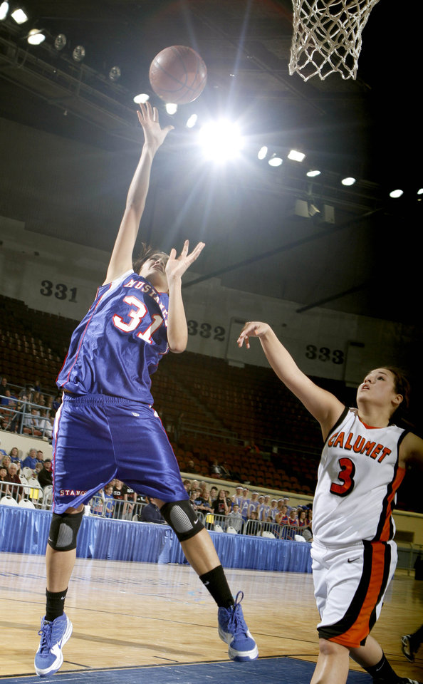 Photo - Ft. Cobb-Broxton's Emeri Tippeconnie shoots over Calumet's Pebbles Island during the girls Class A high school playoff game between Calumet and Ft. Cobb-Broxton, Thursday, March 4, 2010, at the State Fair Arena in Oklahoma City. Photo by Sarah Phipps, The Oklahoman