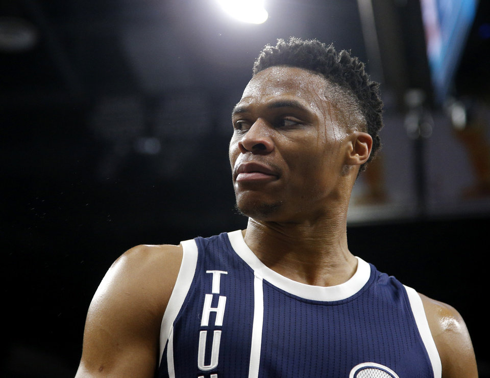 Photo - Oklahoma City's Russell Westbrook (0) looks towards an official during Game 1 of the second-round series between the Oklahoma City Thunder and the San Antonio Spurs in the NBA playoffs at the AT&T Center in San Antonio, Saturday, April 30, 2016. Photo by Bryan Terry, The Oklahoman