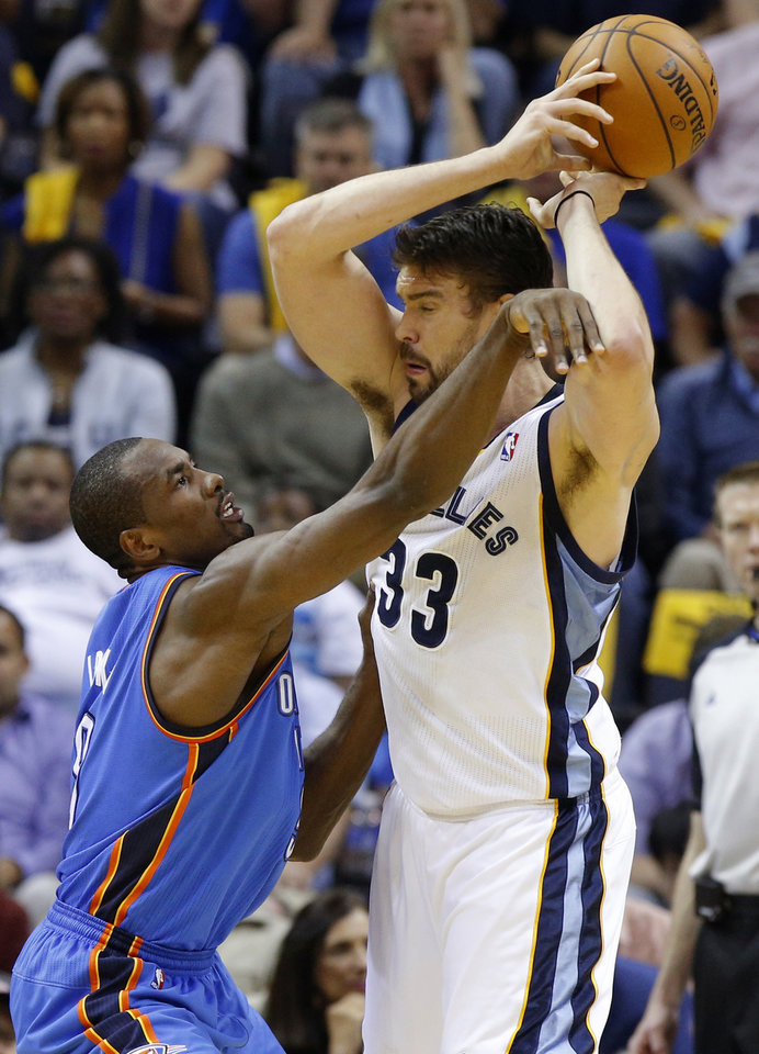 Oklahoma City's Serge Ibaka (9) defends Memphis' Marc Gasol (33) during Game 6  in the first round of the NBA playoffs between the Oklahoma City Thunder and the Memphis Grizzlies at FedExForum in Memphis, Tenn., Thursday, May 1, 2014. Photo by Bryan Terry, The Oklahoman