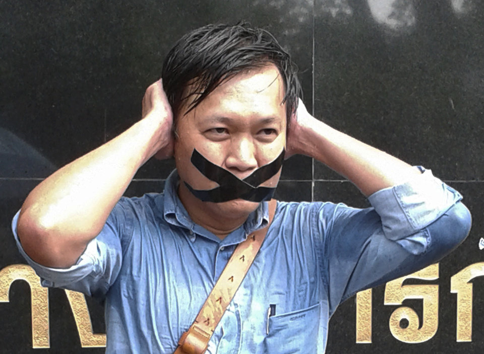 Photo - Pravit Rojanaphruk, an outspoken Thai columnist for the English-language daily The Nation, poses for a photograph while being called to report himself to the ruling military along with other journalists in Bangkok, Thailand Sunday, May 25, 2014. A spokesman for Thailand's coup leaders said Sunday that democracy had caused
