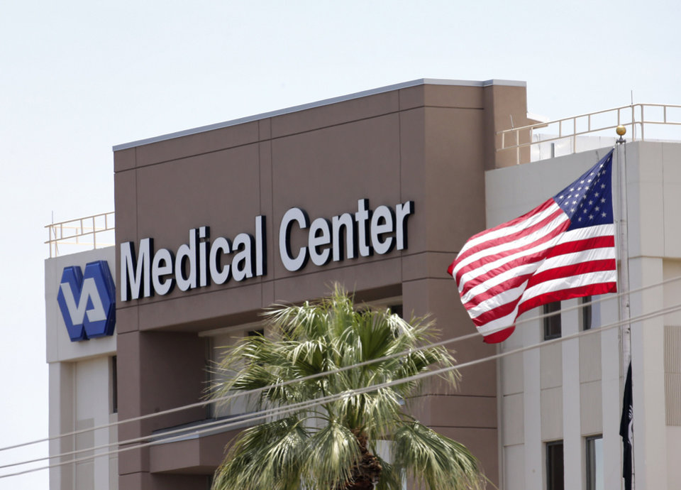 Photo - This photo from Saturday, May 17, 2014 shows the Department of Veterans Affairs in Phoenix. The Veterans Affairs Inspector General's office said late Tuesday, May 20, 2014, that 26 facilities are being investigated nationwide — up from 10 just last week — including a hospital in Phoenix, Arizona, where 40 veterans allegedly died while waiting for treatment and staff there kept a secret list of patients waiting for appointments to hide delays in care. (AP Photo/Matt York)