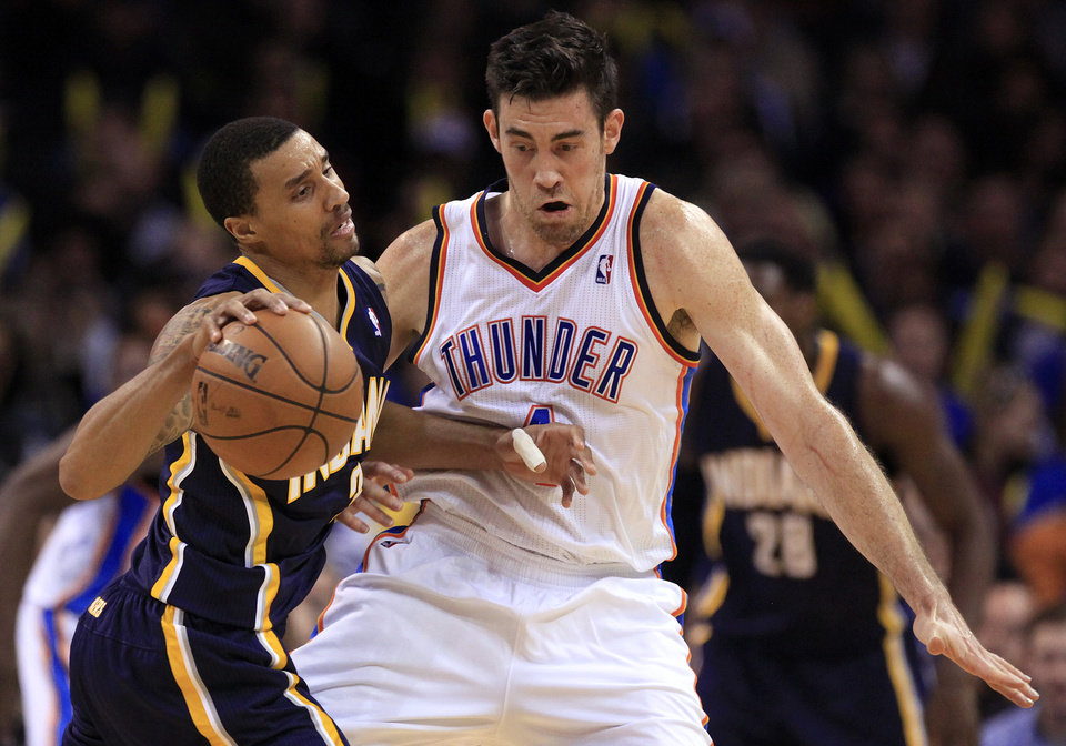 Photo - Oklahoma City's Nick Collison (4) is called for a foul while defending Indiana's George Hill (3) during the NBA game between the Indiana Pacers and the Oklahoma City Thunder at the Chesapeake Energy Arena   Sunday,Dec. 9, 2012. Photo by Sarah Phipps, The Oklahoman