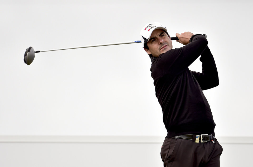 Photo - Felipe Aguilar from Chile plays a tee shot during the first round of the Made in Denmark golf tournament, in Himmerland, Denmark, Thursday, Aug. 14, 2014. (AP Photo/Polfoto, Rene Schutze) DENMARK OUT