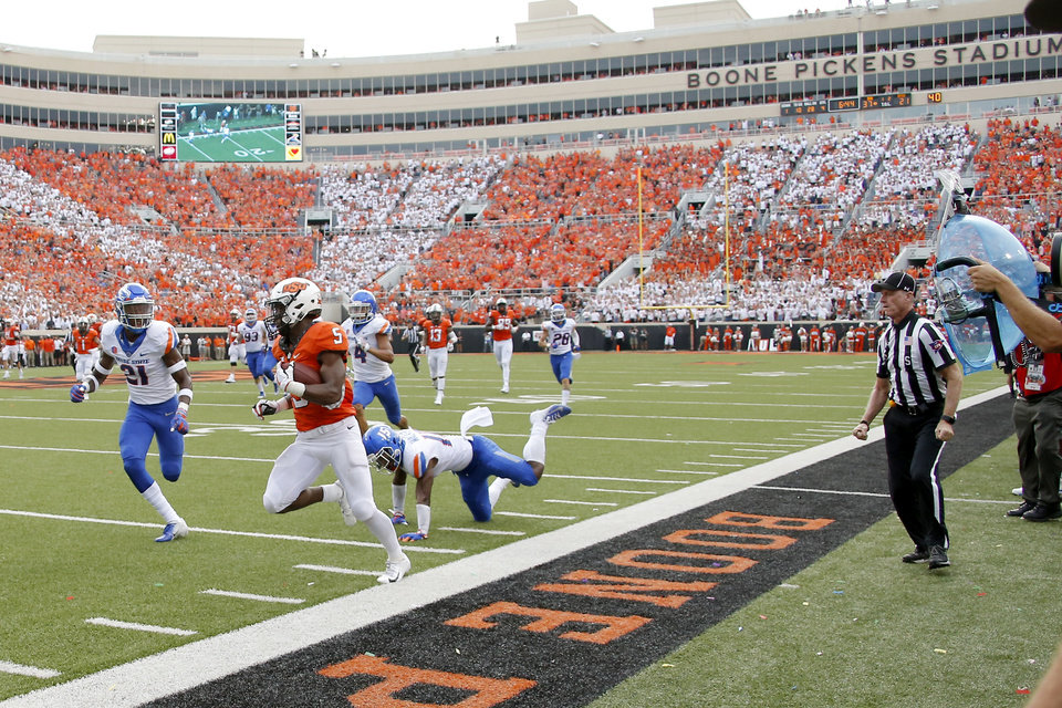 Photo - Oklahoma State's Justice Hill (5) steps out during a long run in a college football game between the Oklahoma State University Cowboys (OSU) and the Boise State Broncos at Boone Pickens Stadium in Stillwater, Okla., Saturday, Sept. 15, 2018. Oklahoma State won 44-21. Photo by Bryan Terry, The Oklahoman