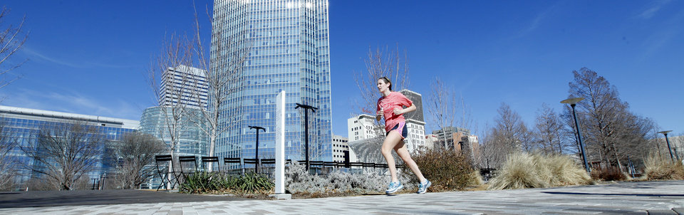 A jogger runs in shorts Monday at the Myriad Botanical Gardens in downtown Oklahoma City.  Photos by David McDaniel, The Oklahoman  <strong>David McDaniel -   </strong>