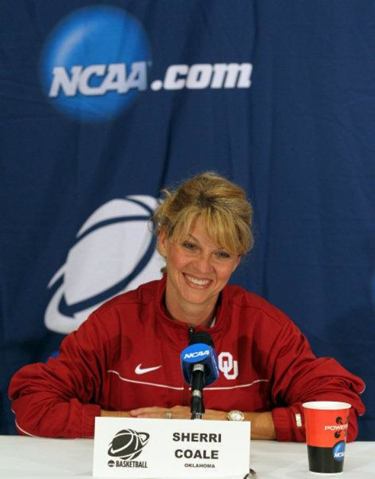Photo - Oklahoma head coach Sherri Coale talks about the 86-72 win over James Madison in the first round of the NCAA women's college basketball tournament during a news conference, Monday, March 21, 2011, in Charlottesville, Va. Oklahoma plays Miami in the second round of the tournament on Tuesday. (AP Photo/Andrew Shurtleff)  Andrew Shurtleff