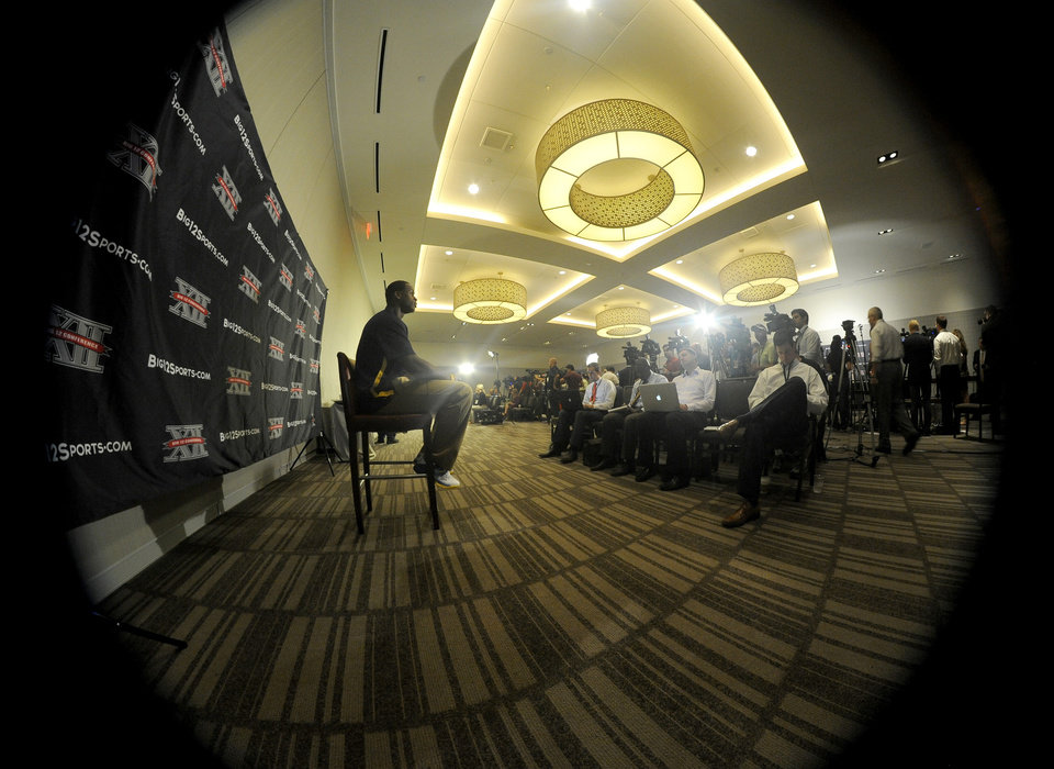 West Virginia quarterback Geno Smith, left, answers questions at NCAA college football Big 12 Media Days, Tuesday, July 24, 2012, in Dallas. (AP Photo/Matt Strasen)