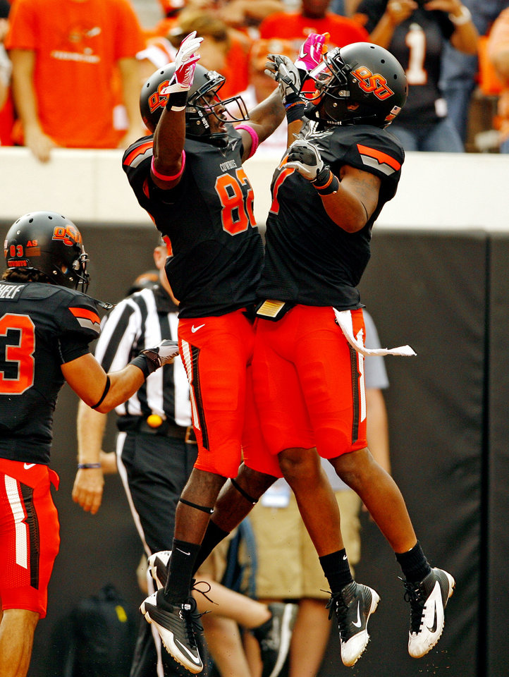 Oklahoma State's Isaiah Anderson celebrates his touchdown reception with Oklahoma State's Michael Harrison (7)during a college football game between the Oklahoma State University Cowboys (OSU) and the University of Kansas Jayhawks (KU) at Boone Pickens Stadium in Stillwater, Okla., Saturday, Oct. 8, 2011 Photo by Steve Sisney, The Oklahoman