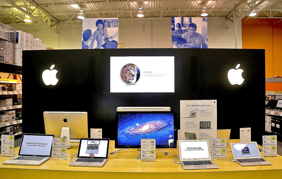 Photo - Apple products on display at a Best Buy in Oklahoma City.