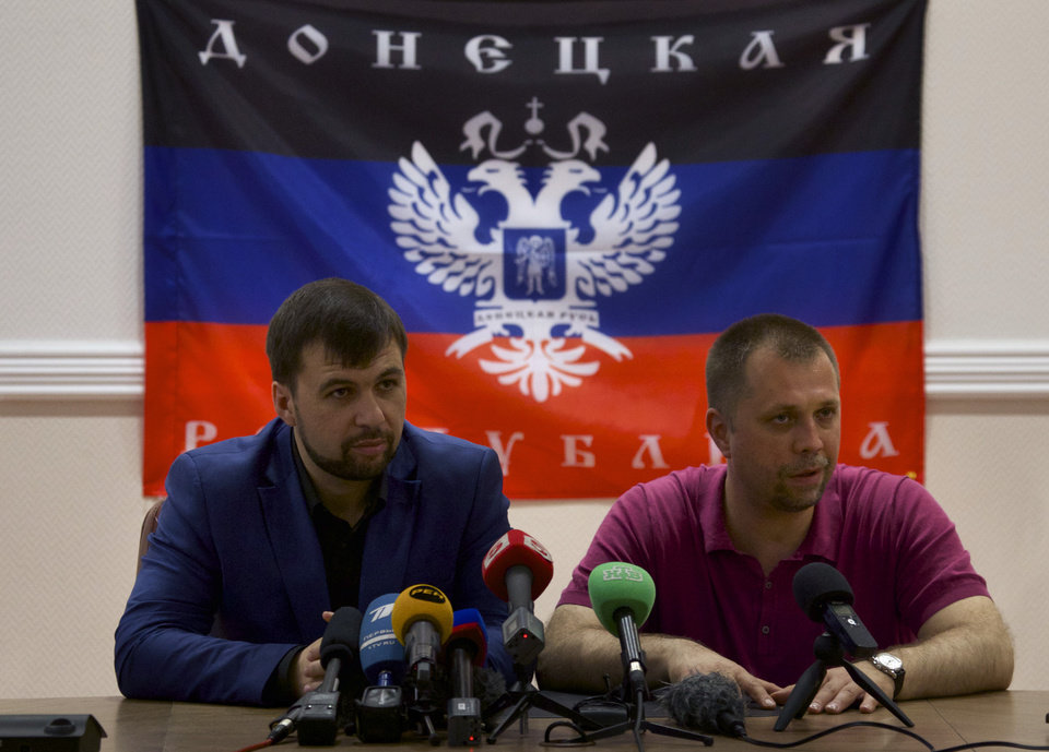 Photo - Denis Pushilin, Chairman of self-declared Supreme Council of Donetsk People's Republic, left, and Alexander Borodai, Republic's Prime Minister, speak to the media in Donetsk, Ukraine, on Thursday, May 29, 2014. Prime Minister of the self-proclaimed Donetsk People's Republic /DNR/ Alexander Borodai said dozens of people had been killed in the military operation of the Ukrainian authorities in the Donetsk area. (AP Photo/Ivan Sekretarev)
