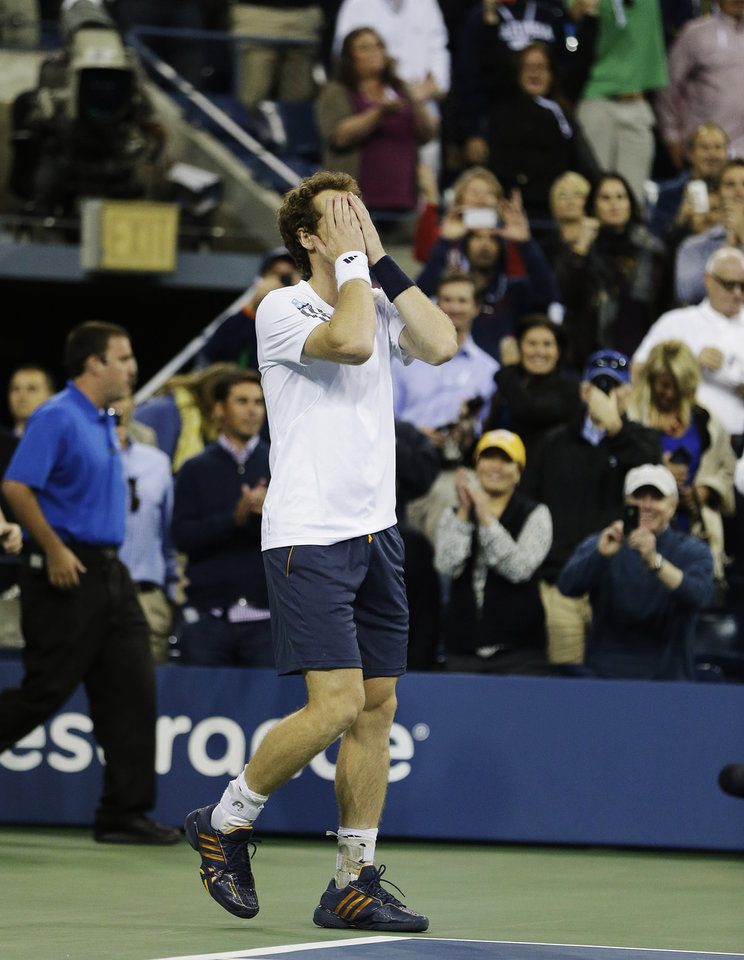 Photo -   Britain's Andy Murray reacts after beating Serbia's Novak Djokovic in the championship match at the 2012 US Open tennis tournament, Monday, Sept. 10, 2012, in New York. (AP Photo/Darron Cummings)