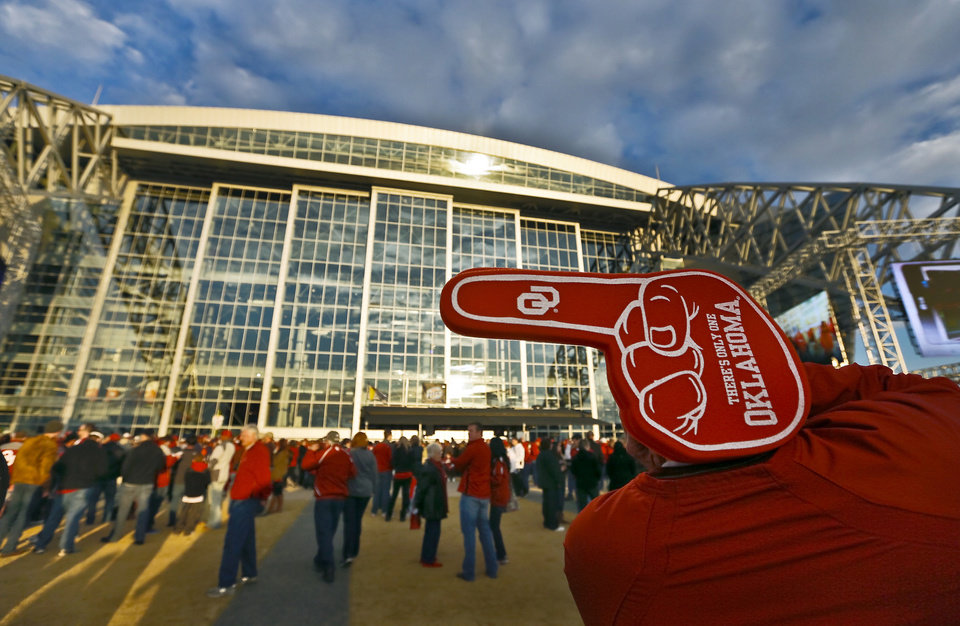 Photo - An OU fan stands outside the stadium during the college football Cotton Bowl game between the University of Oklahoma Sooners (OU) and Texas A&M University Aggies (TXAM) at Cowboy's Stadium on Friday Jan. 4, 2013, in Arlington, Tx. Photo by Chris Landsberger, The Oklahoman