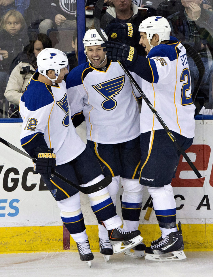 Photo - St. Louis Blues' Derek Roy (12), Brenden Morrow (10) and Chris Stewart (25) celebrate after scoring against the Edmonton Oilers during the second period of an NHL hockey game in Edmonton, Alberta, on Saturday, Dec. 21, 2013. (AP Photo/The Canadian Press, Jason Franson)