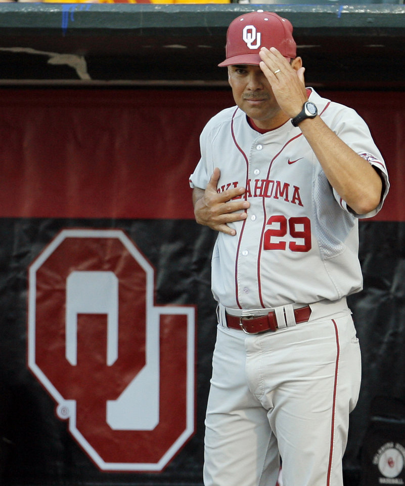 OU head coach Sunny Golloway gives signs from the dugout during the Big 12 Tournament. By Nate Billings