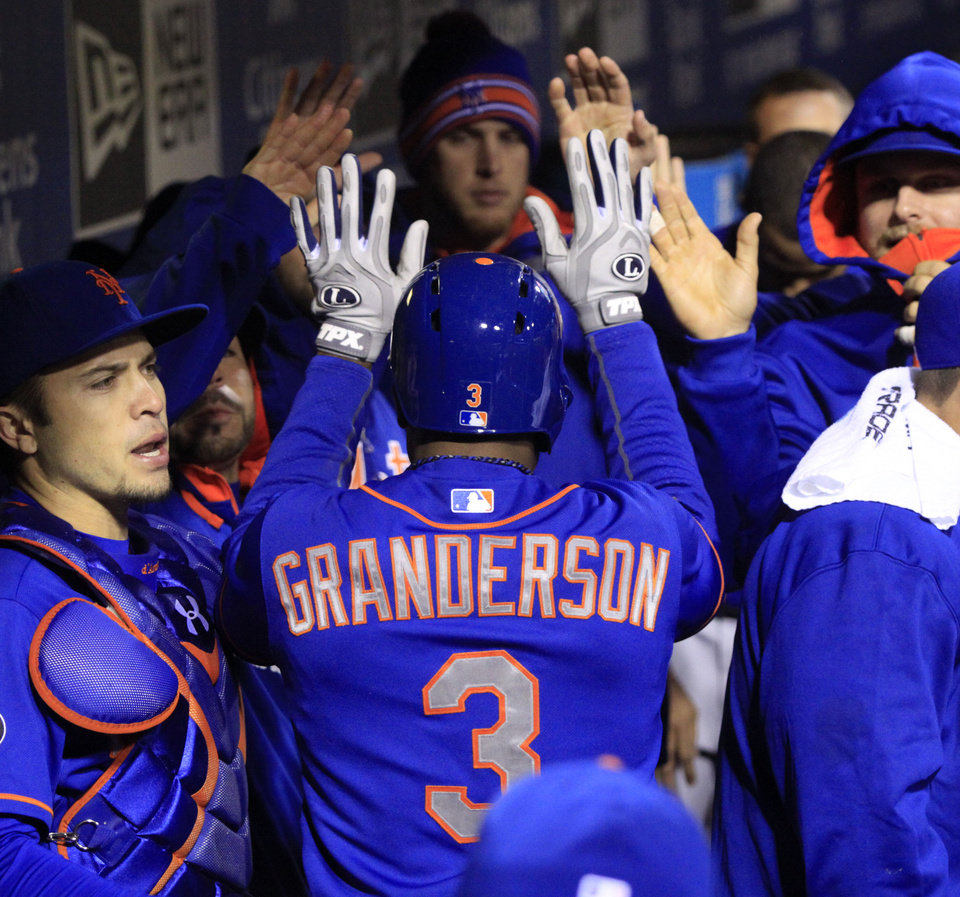 Photo - New York Mets' Curtis Granderson (3) celebrates with teammates after he scored against the Philadelphia Phillies in the fourth inning of a baseball game Tuesday, April 29, 2014, in Philadelphia.  (AP Photo/H. Rumph Jr)