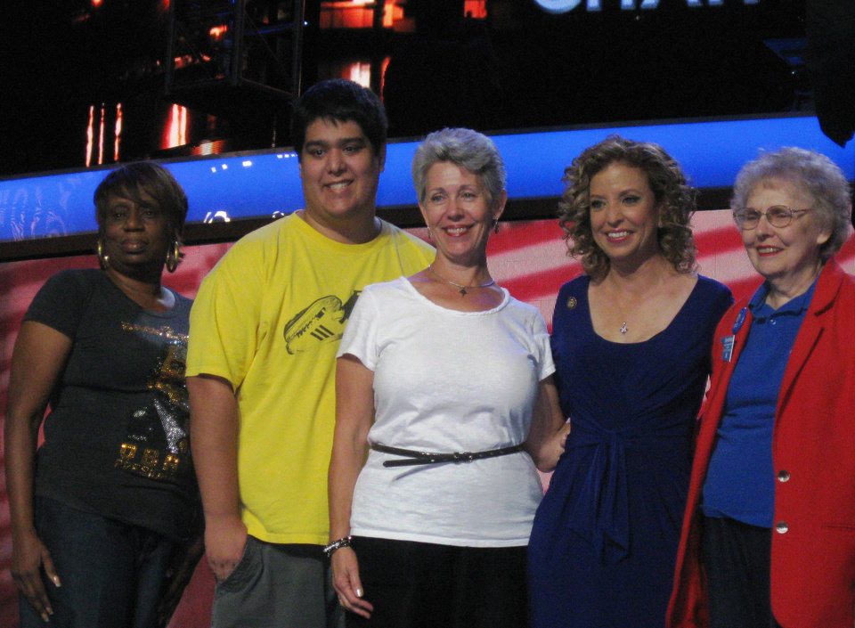 Oklahoma Democrats visit the stage on Sunday at the Time Warner Cable Arena in Charlotte, NC, as preparations continue for the Democratic National Convention. From left to right, Christine Byrd, David Scott, Dana Orwig, Democratic National Committee Chairman Debbie Wasserman Schultz and Betty McElderry. <strong>Chris Casteel - The Oklahoman</strong>