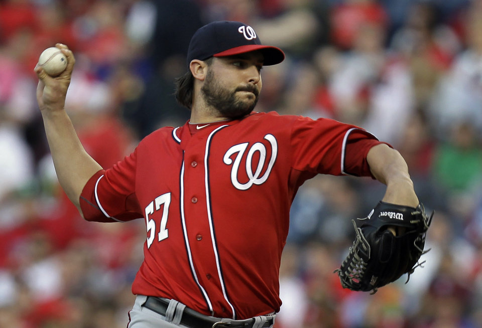 Photo - Washington Nationals' pitcher Tanner Roark throws in the first inning of a baseball game against the Philadelphia Phillies, Saturday, May 3, 2014, in Philadelphia. (AP Photo/Laurence Kesterson)