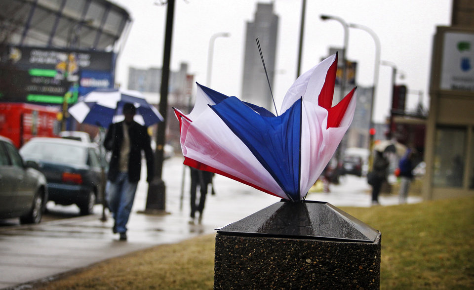 An umbrella lies discarded in trash receptacle in Minneapolis, as foul weather takes hold of the Twin Cities on Tuesday, April 9, 2013. (AP Photo/Star Tribune, David Joles) ST. PAUL OUT  MINNEAPOLIS-AREA TV OUT  MAGS OUT