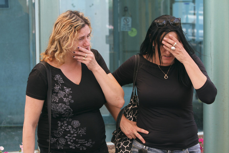 Photo -   Israeli women whose relatives were among the victims of a bombing in Bulgaria that killed seven people on Wednesday, July 18, 2012 wait for their arrival at the Ben Gurion airport in Tel Aviv, Israel, Thursday, July, 19, 2012. The bombing was the latest in a series of attacks attributed to Iran that have targeted Israelis and Jews overseas and threatened to escalate a shadow war between the two arch-enemies. (AP Photo/Dan Balilty)
