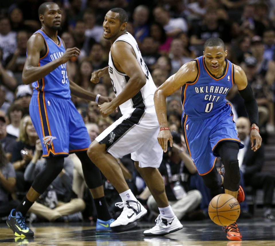 Photo - Oklahoma City's Russell Westbrook (0) goes for the ball in front of Kevin Durant (35) and San Antonio's Boris Diaw (33) during Game 2 of the Western Conference Finals in the NBA playoffs between the Oklahoma City Thunder and the San Antonio Spurs at the AT&T Center in San Antonio, Wednesday, May 21, 2014. Photo by Sarah Phipps, The Oklahoman