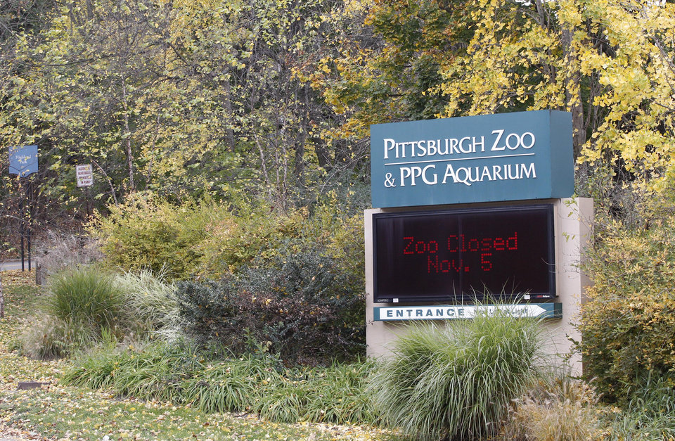 An electronic display sign near the entrance for the Pittsburgh Zoo and PPG Aquarium shows the zoo is closed on Monday, Nov. 5, 2012, in Pittsburgh. Zoo officials said a young boy was killed after he fell into the exhibit that was home to a pack of African painted dogs who pounced on the boy and mauled him on Sunday, Nov. 4, 2012. (AP Photo/Keith Srakocic)