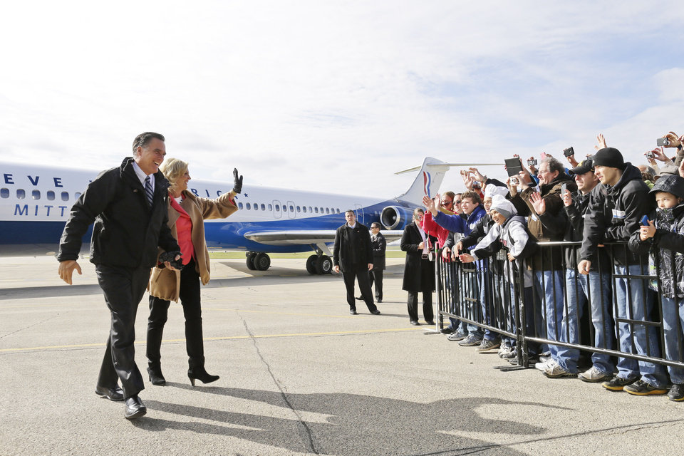 Republican presidential candidate and former Massachusetts Gov. Mitt Romney and Ann Romney walk from their plane as they arrive to campaign at Dubuque Regional Airport, in Dubuque, Iowa, Saturday, Nov. 3, 2012. (AP Photo/Charles Dharapak)